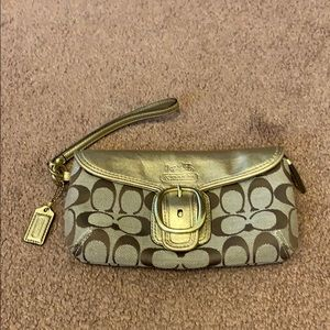 Coach wristlet in gold and tan